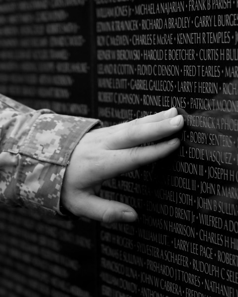 a young soldier touches the Wall