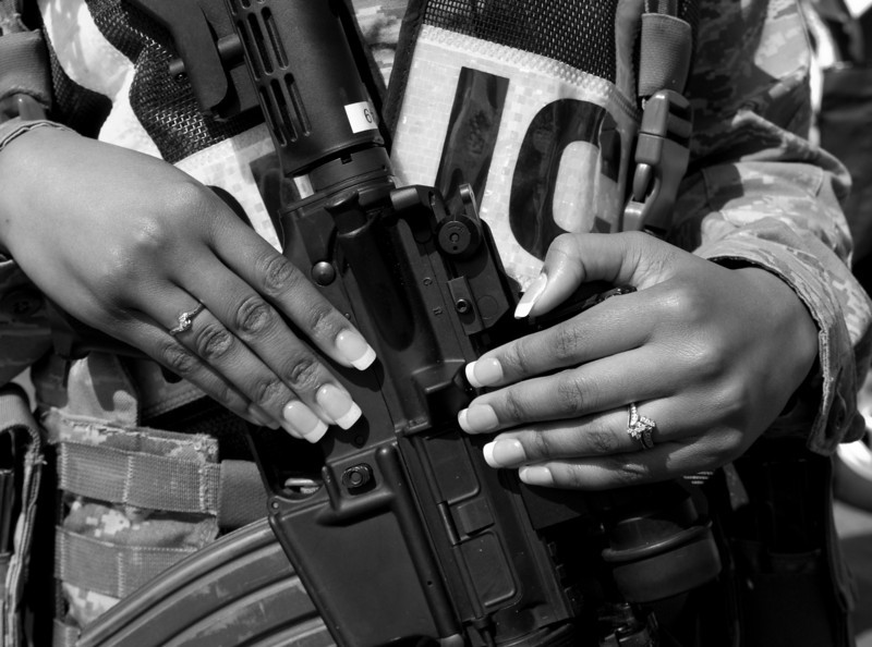 The contrast in this picture appealed to me. The diamonds,manicure and automatic weapon made an interesting image .