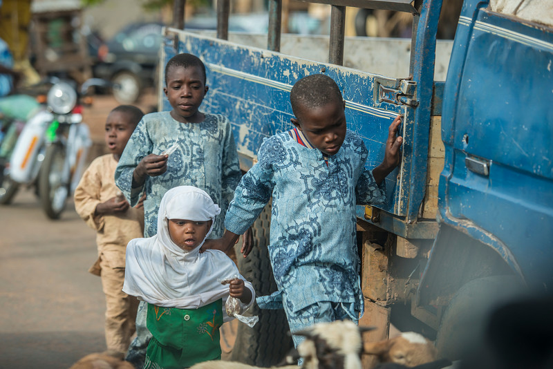Kids running beside car in Benin