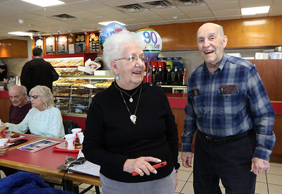 Friends of retired Lowell arson investigator Harold Waterhouse hold a birthday celebration at Top Donut for his 90th birthday. Harold Waterhouse and his wife Marion Waterhouse.  (SUN/Julia Malakie)