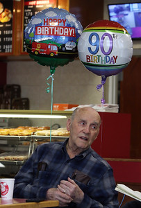 Friends of retired Lowell arson investigator Harold Waterhouse hold a birthday celebration at Top Donut for his 90th birthday. (SUN/Julia Malakie)
