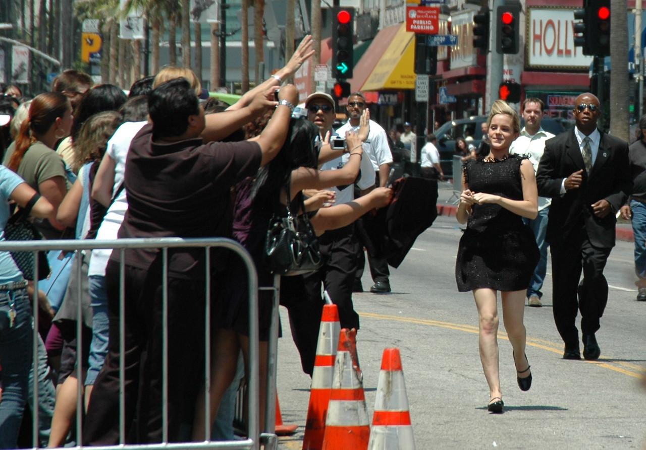 Emma Watson running to her fans