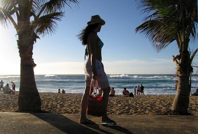 Female walking along the path at Sunset Beach North Shore of O'ahu, Hawai'i