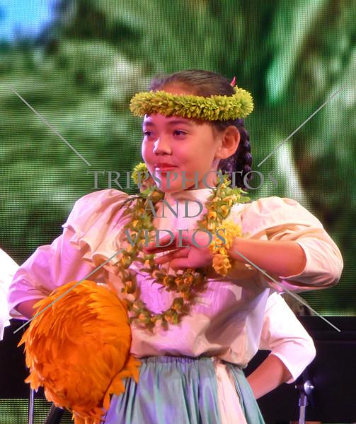 Young girls perform traditional Hawaiian dances in Honolulu, Hawaii.