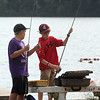 Features at Heart Pond in Chelmsford. Riley Stout, left, and Ethan McCafferty, both 11 and from Chelmsford, get ready to fish at Heart Pond.  (SUN/Julia Malakie)