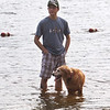 Features at Heart Pond in Chelmsford. David Rossi of Westford watches his field golden retriever, Jordan, wade in Heart Pond. (She doesn't swim.) Earlier in the afternoon, she'd been stressed out by the thunderstorm, and they were relaxing with a walk. (SUN/Julia Malakie)