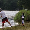 Features at Heart Pond in Chelmsford. Devan Heng of Chelmsford and his sons Ryan Heng, 11, center, and Jayden Heng, 13, fish at Heart Pond.  (SUN/Julia Malakie)