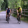 Features at Heart Pond in Chelmsford. Sandy Bell of Sudbury, left, and her companion Joe Bernard of Tewksbury, ride the Bruce Freeman Rail Trail past Heart Pond in Chelmsford, near the end of a 20 mile ride they started in Chelmsford Center.  (SUN/Julia Malakie)