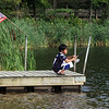 Features at Heart Pond in Chelmsford. Ryan Heng, 11, of Chelmsford, fishes at Heart Pond.  (SUN/Julia Malakie)