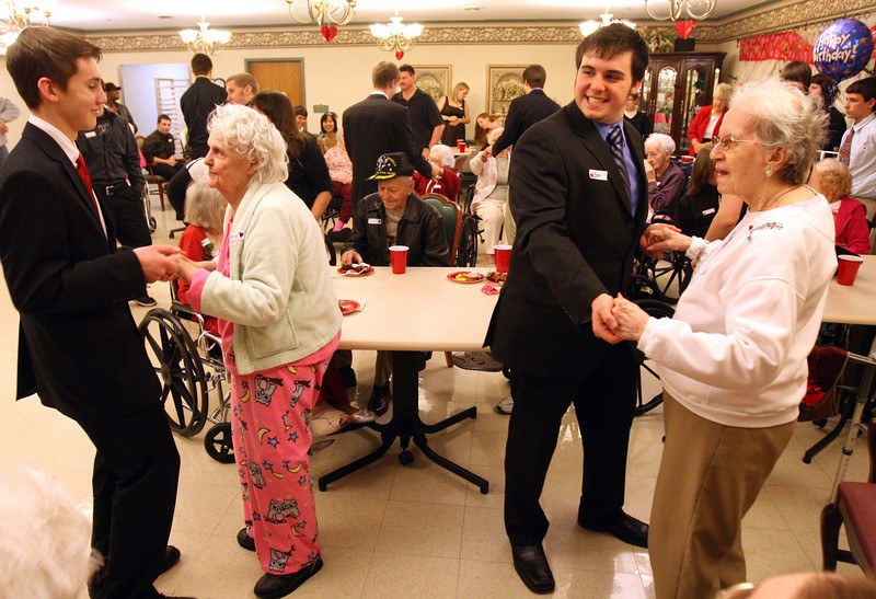 "E.L. Hubbard for the DDN<br /> Connor Slone, 16, and Nerva Elliott, who said she wasn't old enough to give her age, and Aaron Saxe, 16, and Retha Skahill, 89, dance together during the ""Senior Prom"" Valentine's Day dance at Heartland of Beavercreek Nursing Home Saturday, February 14, 2009. The Beavercreek Youth Council hosted the dance."