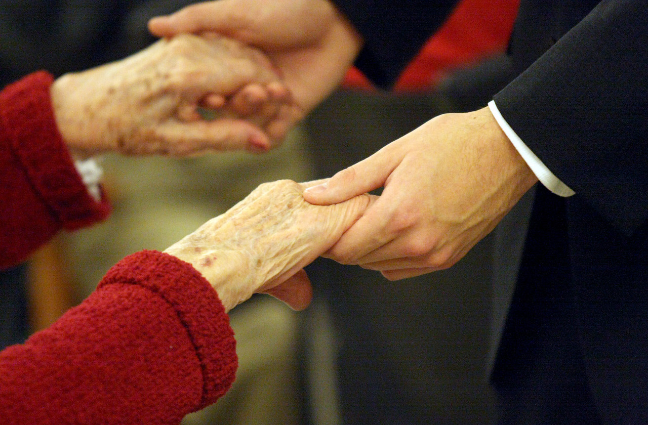 "E.L. Hubbard for the DDN<br /> Old hands and young hands touch during the ""Senior Prom"" Valentine's Day dance at Heartland of Beavercreek Nursing Home Saturday, February 14, 2009. The Beavercreek Youth Council hosted the dance."