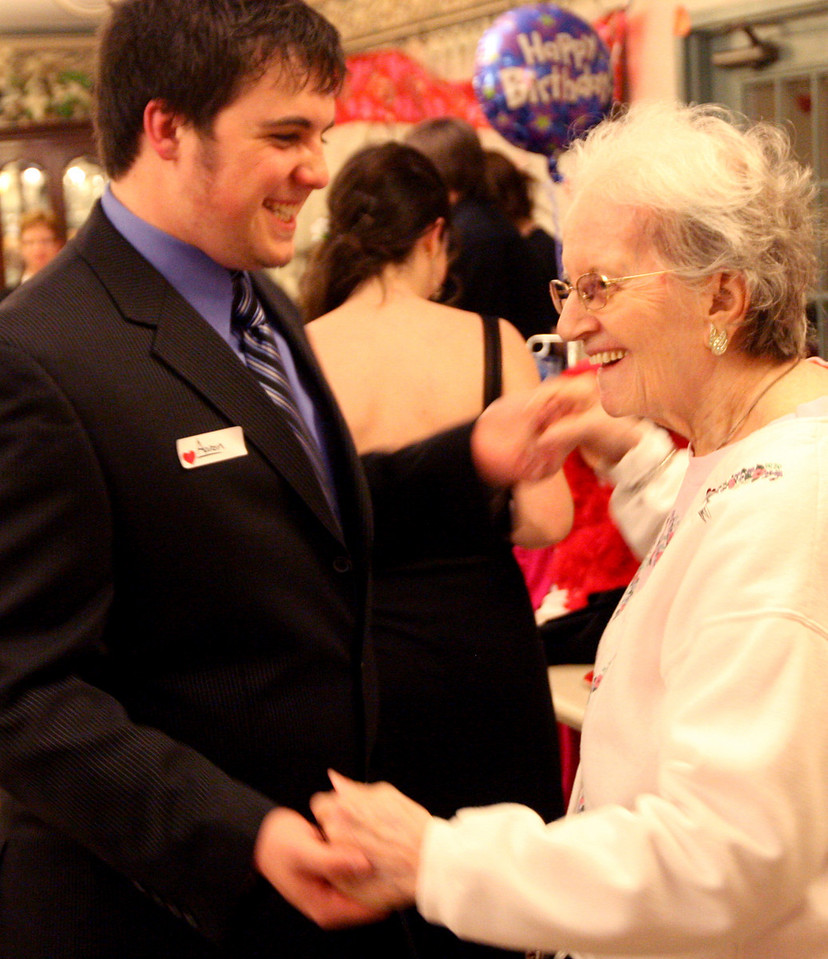 "E.L. Hubbard for the DDN<br /> Aaron Saxe, 16, and Retha Skahill, 89, dance together during the ""Senior Prom"" Valentine's Day dance at Heartland of Beavercreek Nursing Home Saturday, February 14, 2009. The Beavercreek Youth Council hosted the dance."
