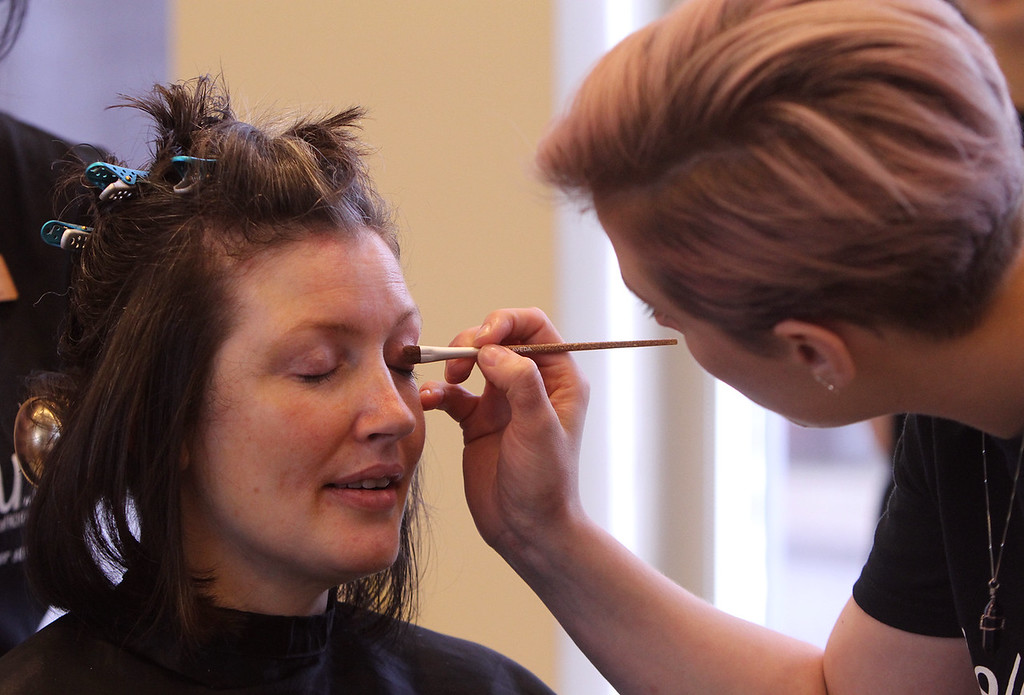. Donna Rains of Somerville, who is being treated for a recurrence of breast cancer, is treated to a surprise makeover at Pyara Spa and Salon in Burlington, the first salon in Massachusetts participating in the Hello Gorgeous program. Esthetician and makeup artist Susie Bowers of Allston does makeup. (SUN/Julia Malakie)