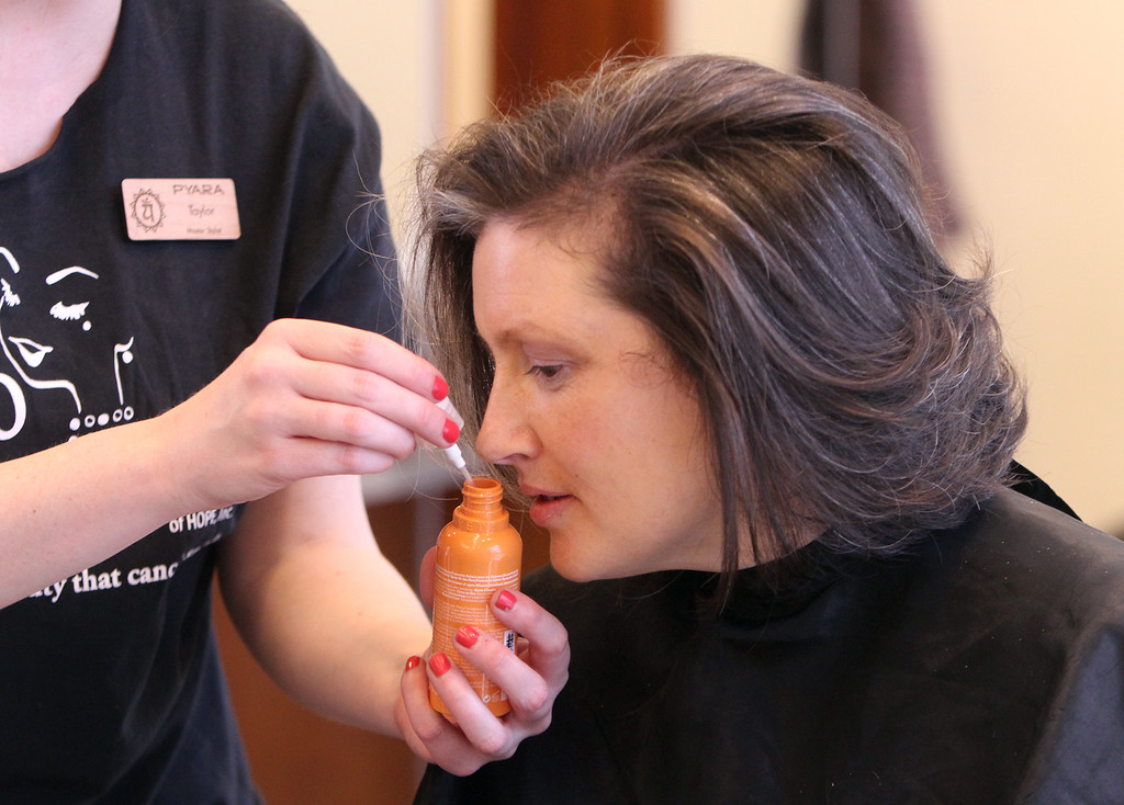 . Donna Rains of Somerville, who is being treated for a recurrence of breast cancer, is treated to a surprise makeover at Pyara Spa and Salon in Burlington, the first salon in Massachusetts participating in the Hello Gorgeous program. Master stylist Taylor Macdonald let Rains small all the products she\'ll be using. (SUN/Julia Malakie)