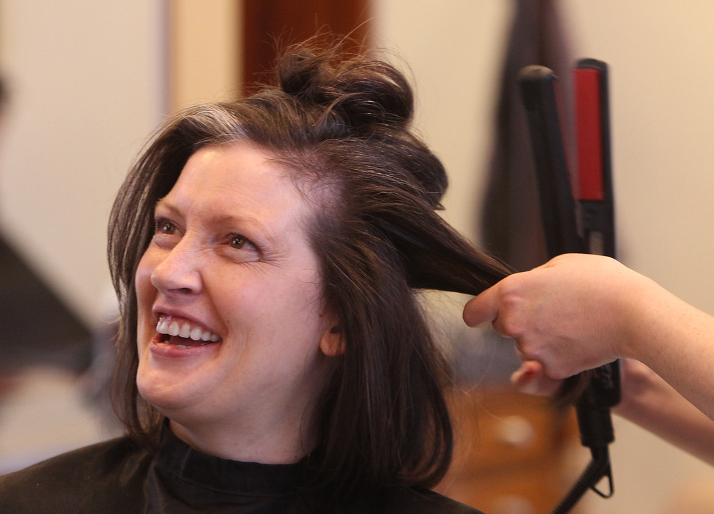 . Donna Rains of Somerville, who is being treated for a recurrence of breast cancer, is treated to a surprise makeover at Pyara Spa and Salon in Burlington, the first salon in Massachusetts participating in the Hello Gorgeous program. (SUN/Julia Malakie)
