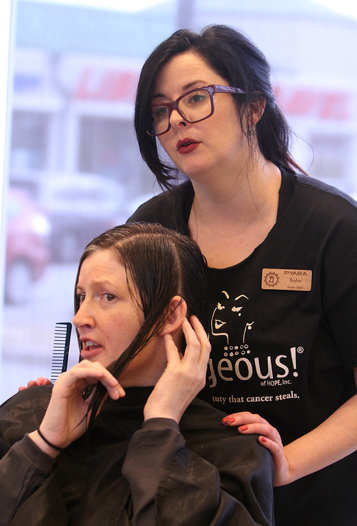 . Donna Rains of Somerville, who is being treated for a recurrence of breast cancer, is treated to a surprise makeover at Pyara Spa and Salon in Burlington, the first salon in Massachusetts participating in the Hello Gorgeous program. Rains and master stylist Taylor Macdonald discuss her haircut. (SUN/Julia Malakie)