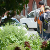 Scott Frittz, 19, and dad Michael Gibson, of Ohio, have been hitchhiking up and down the east coast since June 26. They stopped through Fitchburg and Leominster on July 10th and 11th. The duo walks down West Street on Friday afternoon to find their next ride. SENTINEL & ENTERPRISE / Ashley Green