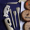 Some bone work, in the middle are three hairpins.