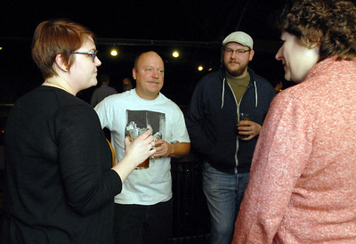 Tom Fitzpatrick of Batavia enjoys the holiday party with members of the Urban Knaves of Grain home brewers' club (left) Livia Glatz of South Elgin, Kyle Teichart of South Elgin and Ellen Janevicius of Naperville at Two Brothers Roundhouse Wednesday Dec. 19, 2012. Tom was recently a finalist in the Sam Adams Home Brew Contest. Erica Benson—ebenson@shawmedia.com