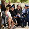 Honor Guard offers a folded US flag to a family during a military funeral service at Riverside National Cemetery in Riverside, California.