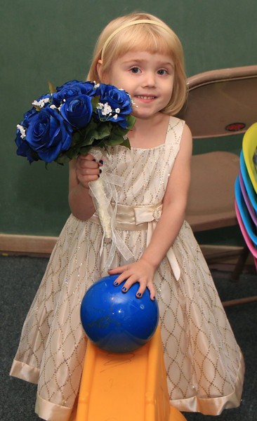 Kiera, one of the flower girls, playing