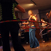 """Kristina Sutcliffe, center, moves the group across the floor during her class.<br /> Hula hoopers of all ages and sizes participated in Kristina Sutcliffe's hula class at Kake's Studio in Boulder.<br /> For more photos and a video,  go to  <a href=""""http://www.dailycamera.com"""">http://www.dailycamera.com</a>.<br /> Cliff Grassmick/ April 23, 2011"""