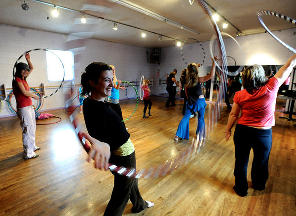 "Brooke Null, foreground, appears to have fun during class.<br /> Hula hoopers of all ages and sizes participated in Kristina Sutcliffe's hula class at Kake's Studio in Boulder.<br /> For more photos and a video,  go to  <a href=""http://www.dailycamera.com"">http://www.dailycamera.com</a>.<br /> Cliff Grassmick/ April 23, 2011"