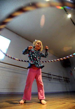 "Evie Miller, 4, has hula hoop skills.<br /> Hula hoopers of all ages and sizes participated in Kristina Sutcliffe's hula class at Kake's Studio in Boulder.<br /> For more photos and a video,  go to  <a href=""http://www.dailycamera.com"">http://www.dailycamera.com</a>.<br /> Cliff Grassmick/ April 23, 2011"
