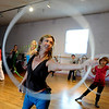 "Kristina Sutcliffe, center, teaches the  group some new moves during her class.Hula hoopers of all ages and sizes participated in Kristina Sutcliffe's hula class at Kake's Studio in Boulder.<br /> For more photos and a video,  go to  <a href=""http://www.dailycamera.com"">http://www.dailycamera.com</a>.<br /> Cliff Grassmick/ April 23, 2011"