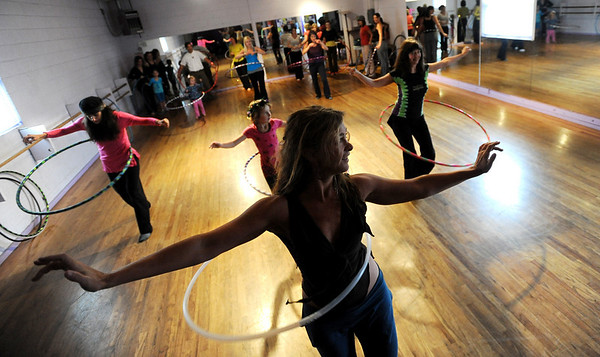 "Kristina Sutcliffe, center, moves the group across the floor during her class.<br /> Hula hoopers of all ages and sizes participated in Kristina Sutcliffe's hula class at Kake's Studio in Boulder.<br /> For more photos and a video,  go to  <a href=""http://www.dailycamera.com"">http://www.dailycamera.com</a>.<br /> Cliff Grassmick/ April 23, 2011"