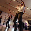 "David Miller brought his family to hoop it up.<br /> Hula hoopers of all ages and sizes participated in Kristina Sutcliffe's hula class at Kake's Studio in Boulder.<br /> For more photos and a video,  go to  <a href=""http://www.dailycamera.com"">http://www.dailycamera.com</a>.<br /> Cliff Grassmick/ April 23, 2011"