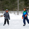 Brothers Joshua Williams, 9, (left) and James Williams, 10, both of Townsend ice skate on the VFW Pond on a chilly Tuesday afternoon in Townsend.<br /> SENTINEL & ENTERPRISE / BRETT CRAWFORD