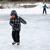 Joshua Williams, 9, (near) and his brother James Williams, 10, both of Townsend ice skate on the VFW Pond on a chilly Tuesday afternoon in Townsend.<br /> SENTINEL & ENTERPRISE / BRETT CRAWFORD
