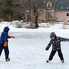 Brothers James Williams, 10, (left) and Joshua Williams, 9, both of Townsend ice skate on the VFW Pond on a chilly Tuesday afternoon in Townsend.<br /> SENTINEL & ENTERPRISE / BRETT CRAWFORD
