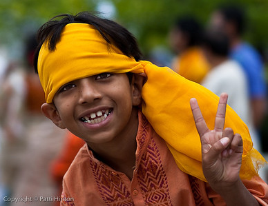 Shaon 35/100 I met Shaon at our local Indiafest today. He was very outgoing and happy to post for the camera once his father asked him to stop moving so I could photograph him. Shaon enjoys skateboarding but was not thrilled at the prospect of dancing at the festival today.