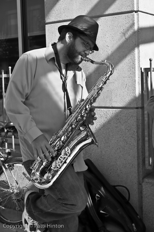 Wolf - Stranger #12 Wolf was busking with friends outside the main library. He plays a mean sax.