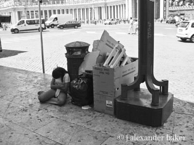 Waiting for the Popemobile. Down and out in Rome.
