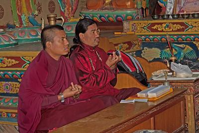 2 monks at prayer in Kathmandu, Nepal