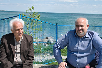 Ehsan, in blue shirt, with his father on the Toronto waterfront.