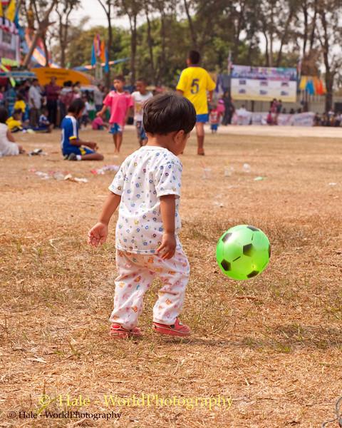 The Little Lao Loum Futball Player