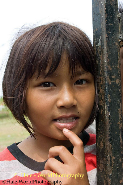 Curious Local Lao Loum Young Girl Watching Go-Go Girls Prepare for Their Show