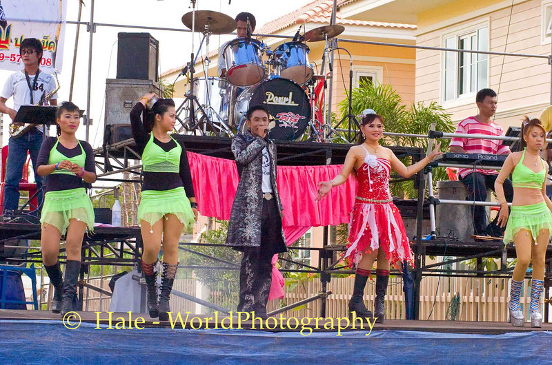 Singer and Go-Go Dancers Performing