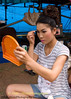 An Isaan Singer and Dancer Prepares to Perform, Tham Chanot Thailand