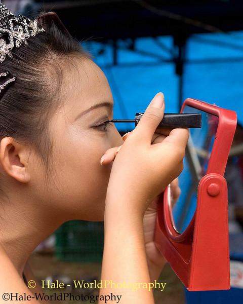 Isaan Go-Go Dancer Applying Eyeliner