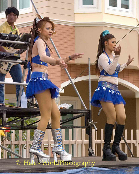 Two Different Go-Go Dancers Performing At House Warming In Udonthani, Thailand