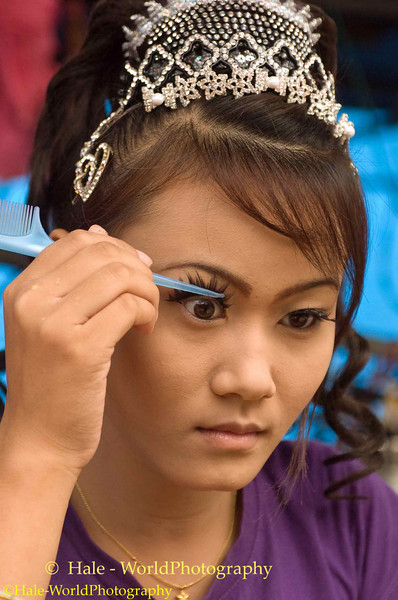 Go-Go Girl Applying Her False Eyelashes Prior to Start of Show At Tham Canot In Isaan Region of Thailand