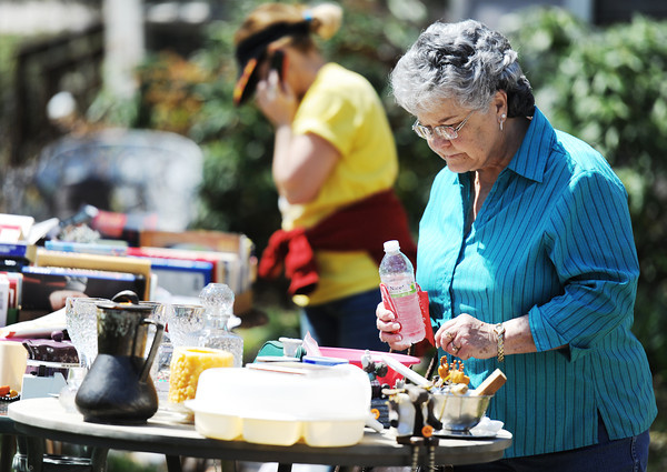 J-Mag/T. Rob Brown<br /> Sandi Roberts, of Grove, Okla., looks through items during the Neosho citywide garage sale Friday afternoon, April 5, 2013. Roberts said she drives up from Grove every year for the event.