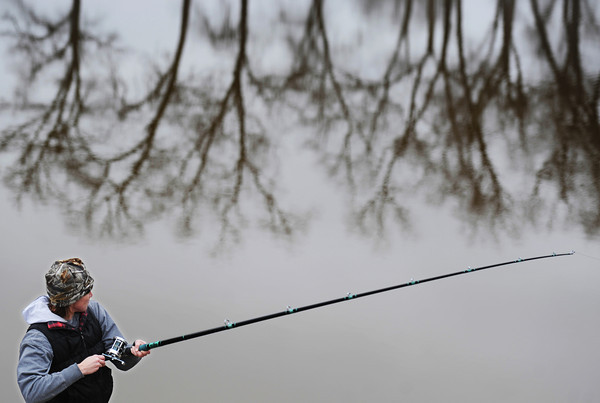 J-Mag/T. Rob Brown<br /> Kristal Lee, of Stillwater, Okla., fishes for paddlefish, or spoonbills, in the Neosho River on the south side of Miami, Okla., Friday morning, March 22, 2013.