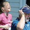 J-Mag/T. Rob Brown<br /> Seven-year-old Kendra Taylor of Neosho laughs after secretly putting her handband on Mark Collier, resident on Oak Ridge Drive in Neosho, during the citywide garage sale Friday afternoon, April 5, 2013.