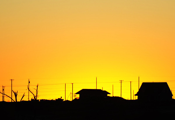 JMag/T. Rob Brown<br /> Houses now silhouette the horizon in Joplin's tornado zone as seen Monday afternoon, Jan. 2, 2012, at sunset.